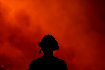 A firefighter keeps an eye on the Holy Fire in southern California.