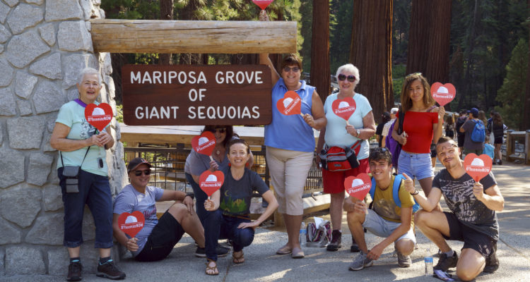 Photo of French tourists in front of the Mariposa Grove at Yosemite National Park