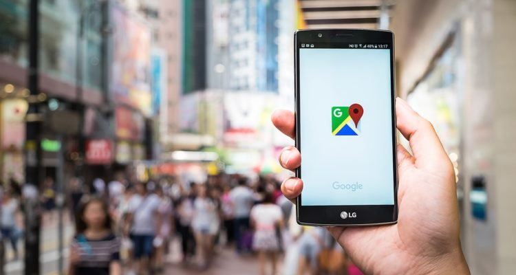 Stock photo of someone holding a smartphone, using google maps