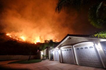 Photo of fire burning near a neighborhood in Lake Elsinore, Calif.