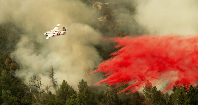Photo of air tanker dropping flame retardant on the Ferguson Fire