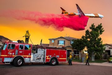 Photo of a plane dropping fire retardant