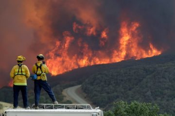 Photo of a fire crew keeping an eye on an advancing wildfire in SLO