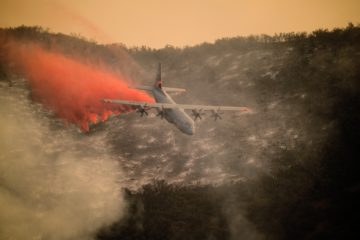 Photo of C 1 30 aircraft dropping flame retardant over Santa Barbara fire in 2017
