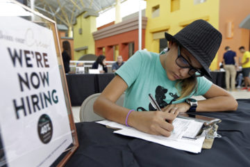 Photo of a job seeker filling out an application
