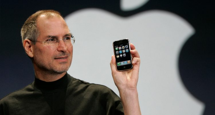 Photo of Steve Jobs holding up iPhone
