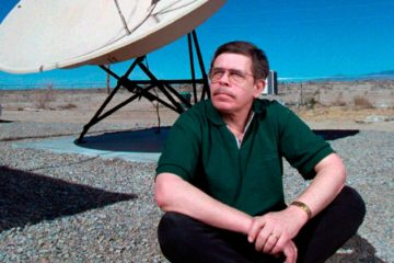 File Photo of Art Bell siting near a satellite in Nevada