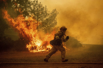 Photo of a running California firefighter