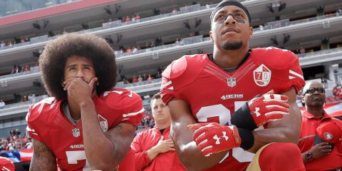 Photo of San Francisco 49ers quarterback Colin Kaepernick, left, and safety Eric Reid