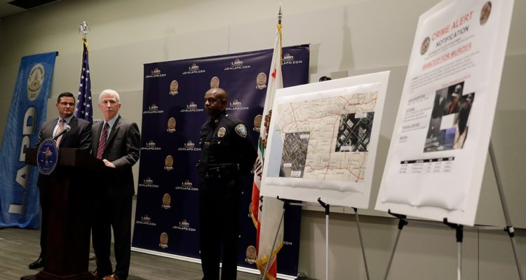 Photo of LAPD Capt. Billy Hayes fielding questions during a press conference