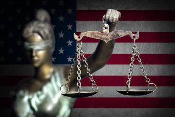 Photo of lady justice and flag background