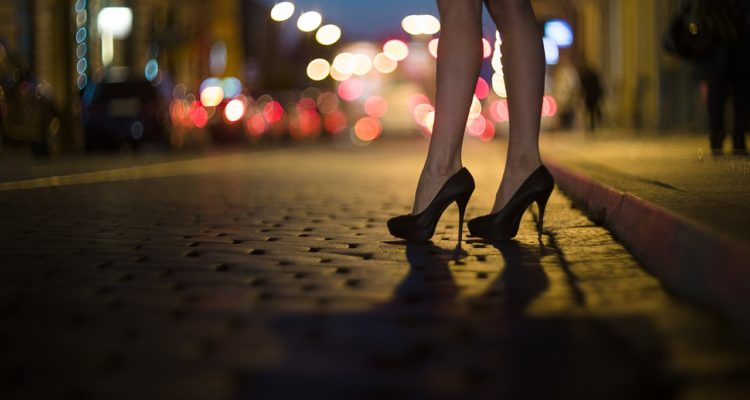 Photo of prostitute on dark street
