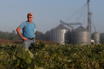 Photo of Jack Maloney overlooking his soybean fields