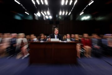 Photo of Kavanaugh in court with a slow shutter speed effect