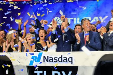 Photo of Brendan Kennedy, CEO and founder of British Columbia-based Tilray Inc., a major Canadian marijuana grower, leading cheers as confetti falls to celebrate