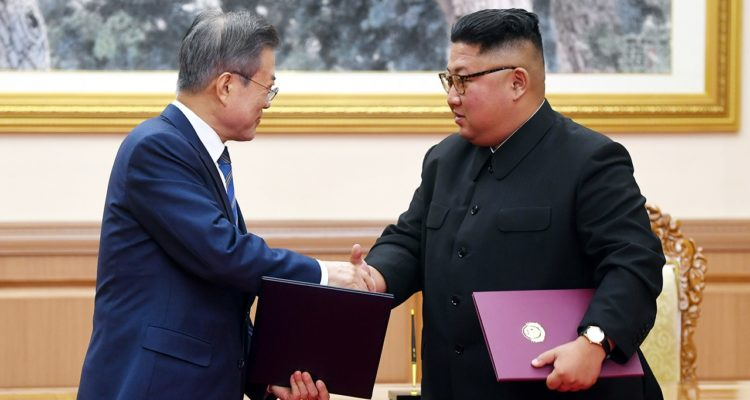 Photo of Kim Jong Un and Moon Jae-in shaking hands
