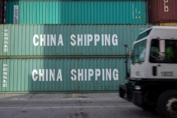 Photo of truck passing China Shipping containers in Savannah, GA