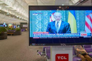 Photo of an airport TV airing CNN News