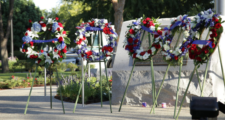 Photo of wreaths and memorial marker in Clovis, California, commemorating the 9-11 terrorist attacks