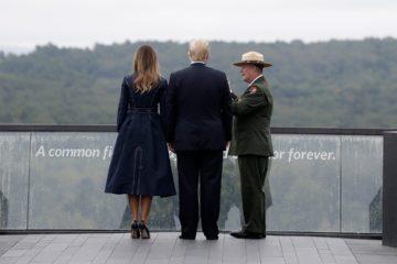 President Donald Trump and first lady Melania Trump walking along the September 11th Flight 93 memorial