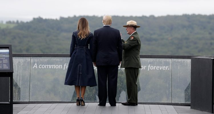 President Donald Trump and first lady Melania Trump walking along the September 11th Flight 93 memorial