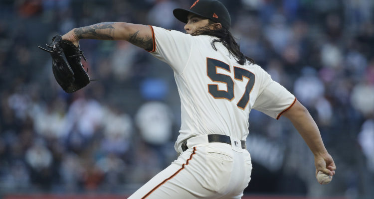 Photo of SF Giants pitcher Dereck Rodriguez in his windup