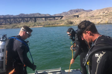 Photo of divers searching for missing people on Colorado River