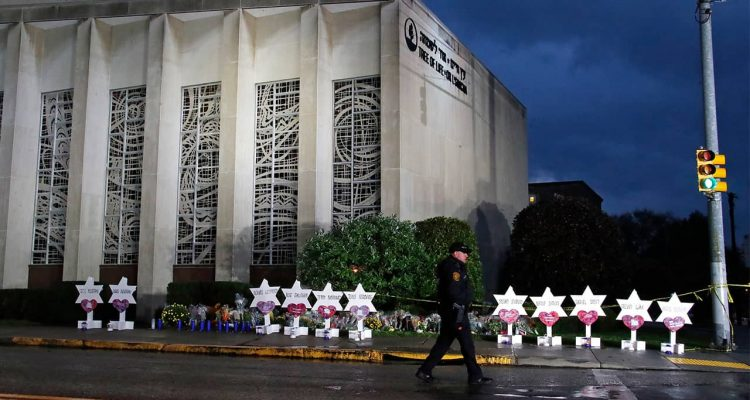 Photo of police officer outside of the Tree of Life Synagogue