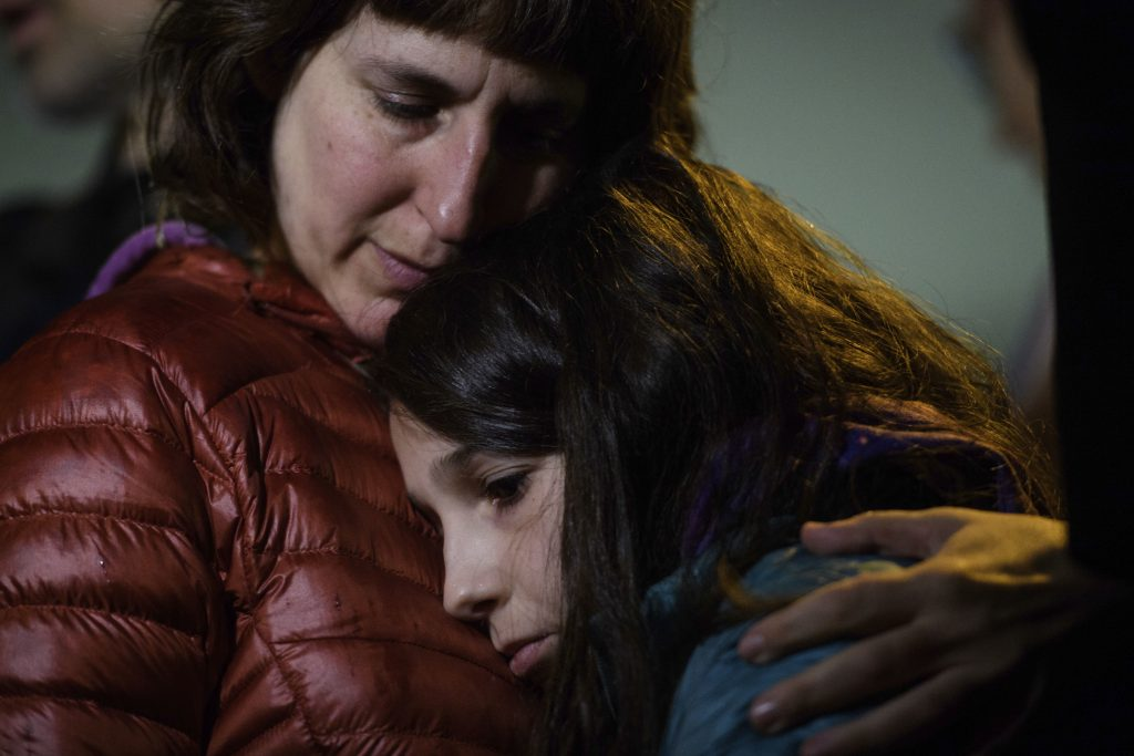 Photo of Pittsburgh residents grieving
