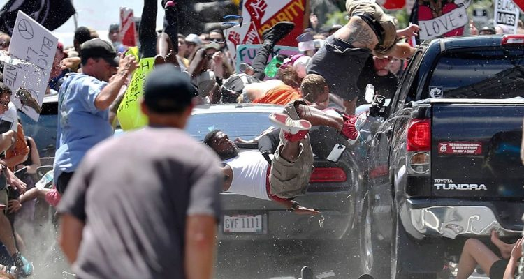 Photo of people flying into the air during a white nationalist rally in Charlottesville, Va.