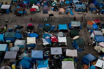 Photo of a large homeless encampment at the Santa Ana Civic Center