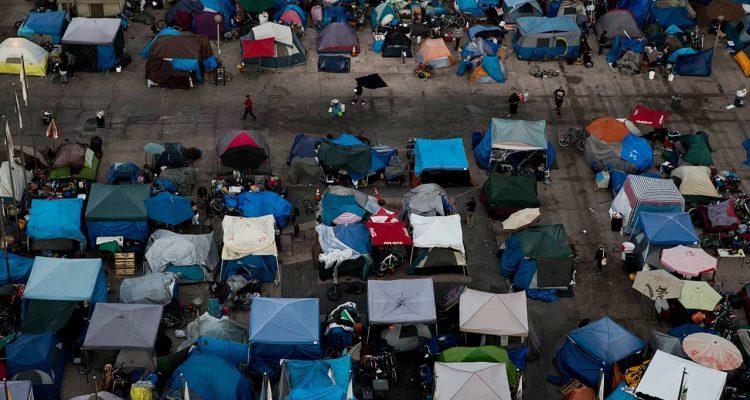 Photo of a large homeless encampment at the Santa Ana Civic Center