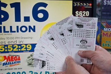 Photo of customer holding Mega Millions lottery tickets in Oklahoma City