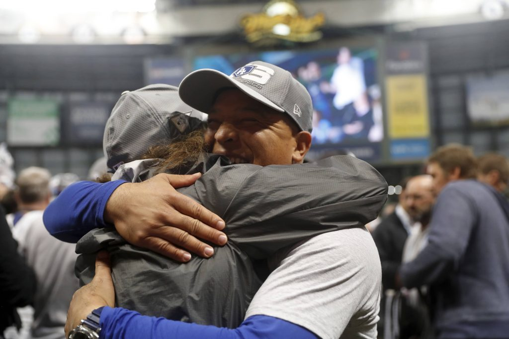 Photo of Los Angeles Dodgers manager Dave Roberts celebrating