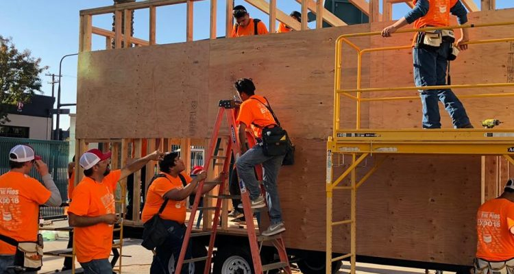 Photo of students working on a tiny house at Career Tech Expo.