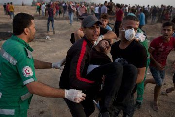 Photo of Palestinians evacuating a wounded protester