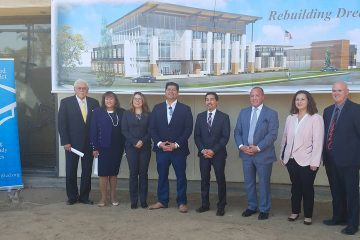 """Photo of Fresno area politicians in front of architect's rendering of the """"Urban Academy"""""""