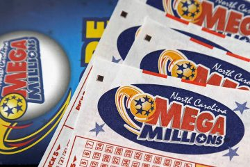 Photo of Mega Millions lottery tickets and logo