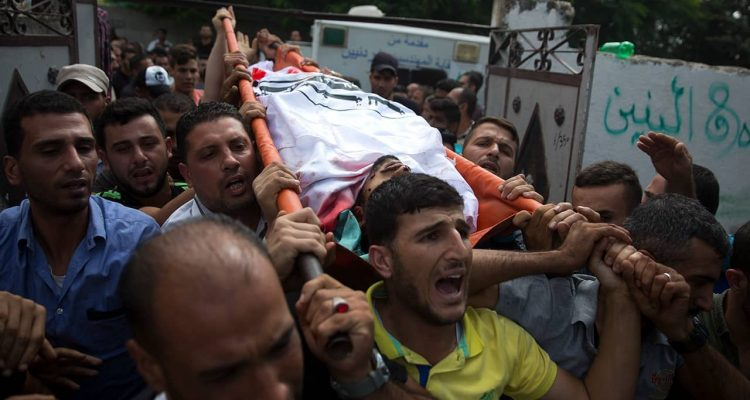 Photo of mourners carrying the body of Palestinian Naji Zaanin, 25