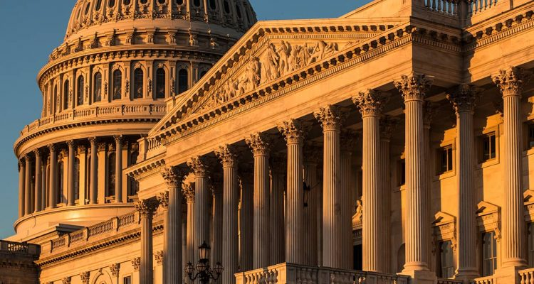 Photo of the Capitol at sunrise in Washington