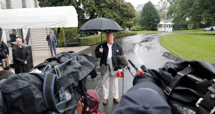 Photo of President Donald Trump talking to media in front of the White House
