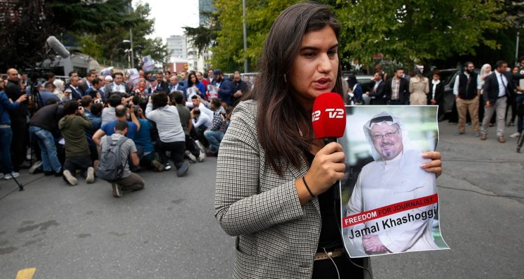Photo of journalist holding a poster of missing Saudi writer Jamal Khashoggi