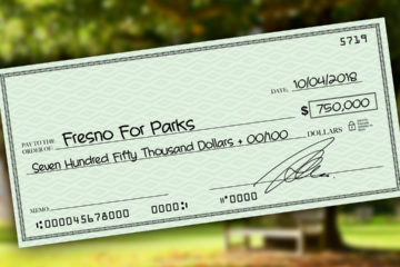 Photo Illustration of a check representing financial support for Yes on P committee