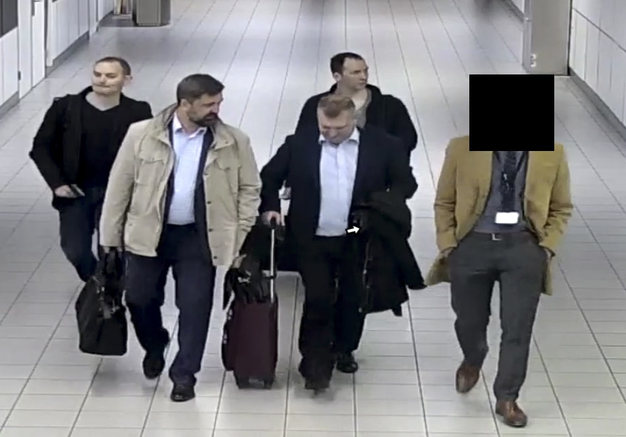 Photo of Russian officers of the Main Directorate of the General Staff of the Armed Forces of the Russian Federation, GRU, being escorted to their flight