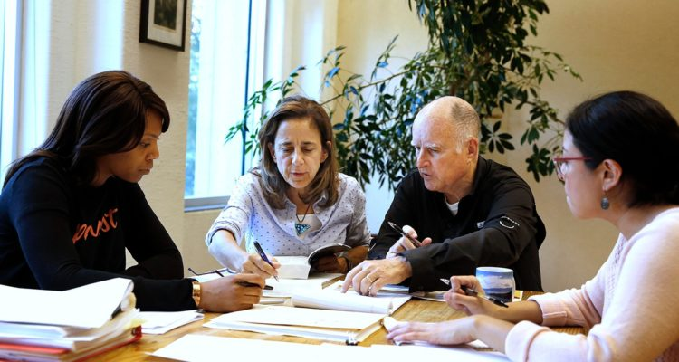 Photo of Gov. Jerry Brown reviewing a measure with his wife