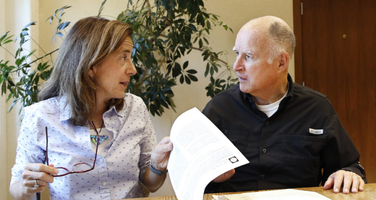 Photo of Gov. Jerry Brown and his wife, Anne Gust Brown, going over legislation.