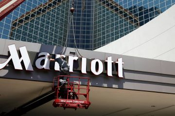 Photo of man working on a Marriott hotel sign