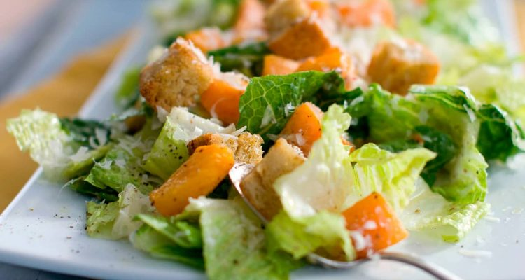 Photo of a caesar salad with romaine lettuce