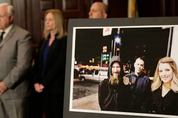 Photo of a picture of Katelyn McClure, right, Mark D'Amico, center, and Johnny Bobbitt Jr.