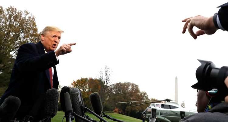 Photo of President Donald Trump talking to the media